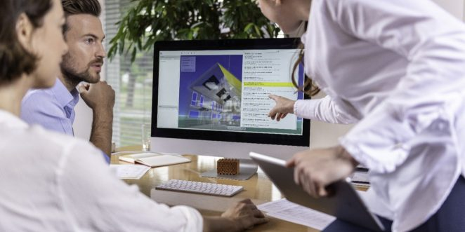 Project managers at office desk working with BIM